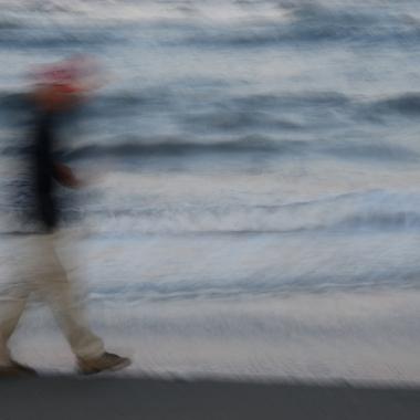 motion blur, man walking on beach, waves, last light of day